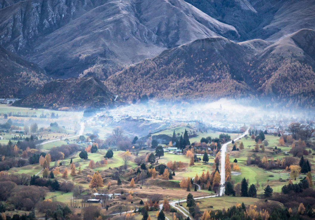 R7FDME Looking towards Arrowtown in Autumn with snow on mountain peaks